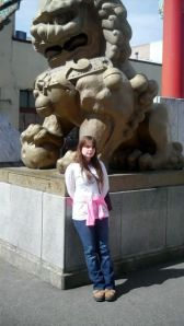 My daughter Emma at Portland's China Town gate.